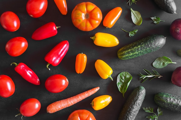 Fresh organic vegetables on a dark background. top view Premium Photo