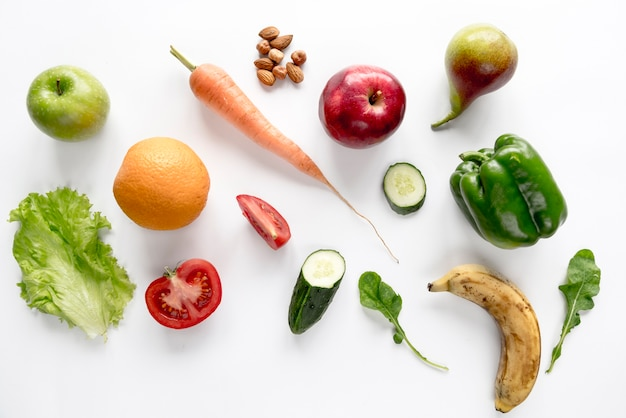 Fresh organic vegetables and fruits isolated over white backdrop Free Photo
