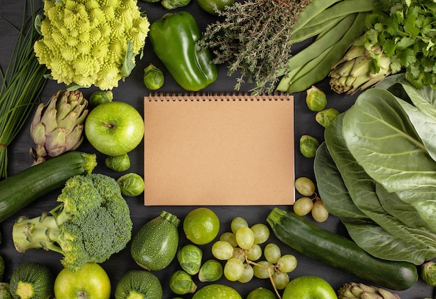 Fresh organic vegetables in green color background Premium Photo