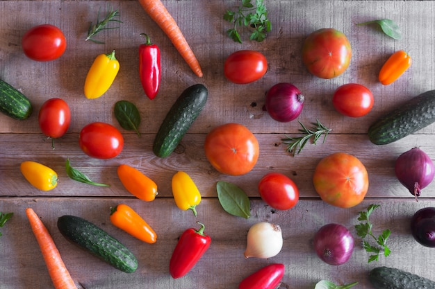 Fresh organic vegetables on a wooden background. top view Premium Photo