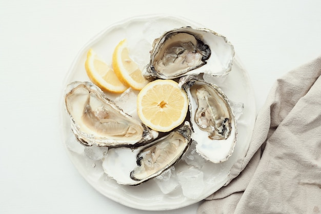 Fresh oyster with lemon on a plate Free Photo