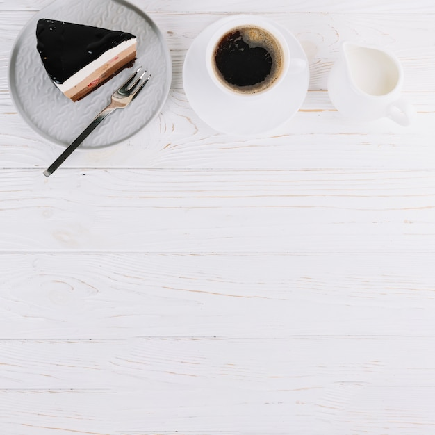 Fresh pastry and cup of tea for breakfast on wooden table Free Photo