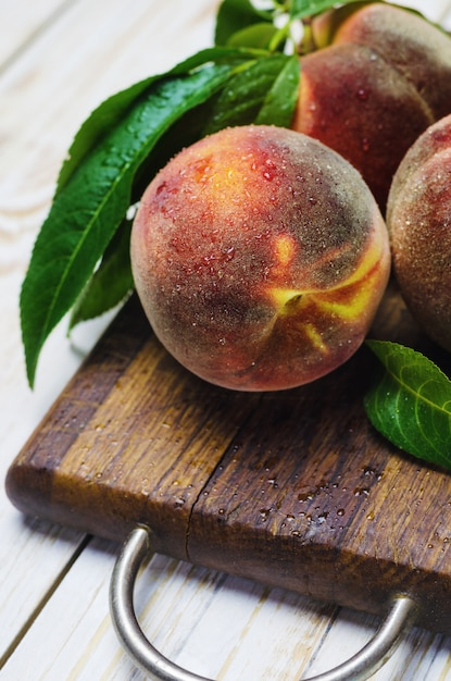 Fresh peaches on wooden Premium Photo