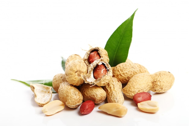 Fresh peanuts on white Free Photo