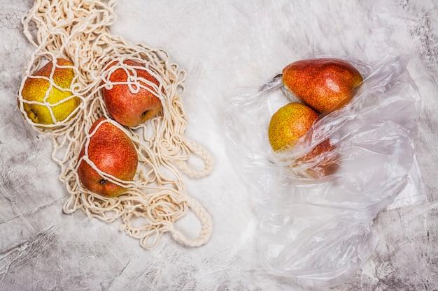 Fresh pears in a mesh bag Premium Photo