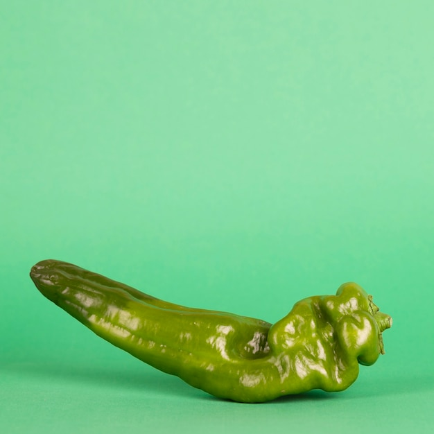 Fresh pepper on green background Free Photo