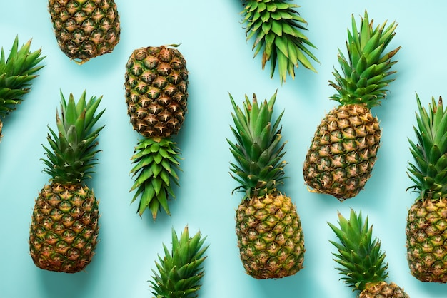 Fresh pineapples on blue background. Premium Photo