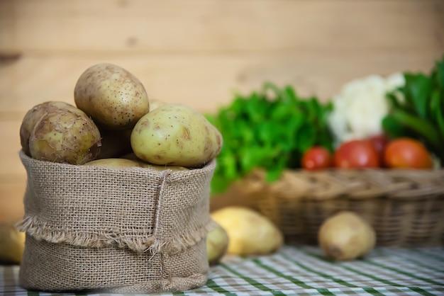 Fresh potato in kitchen ready to be cooked Free Photo