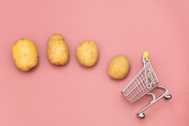 Fresh potatoes and supermarket cart Premium Photo
