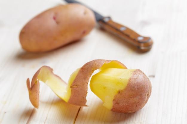 Fresh potatoes on the wood background Premium Photo