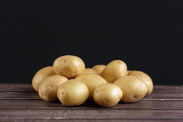Fresh potatoes on the wood Premium Photo