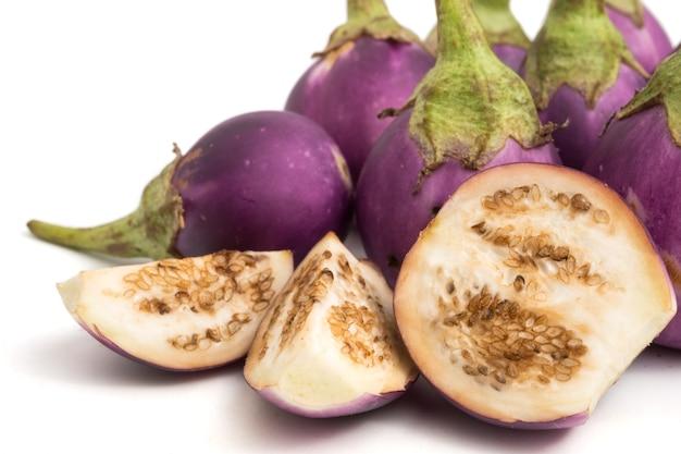 Fresh purple eggplants on white background. Premium Photo