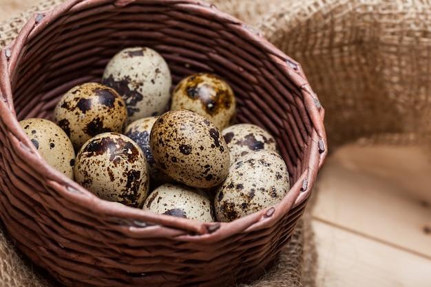 Fresh quail eggs at wooden plate closeup Premium Photo