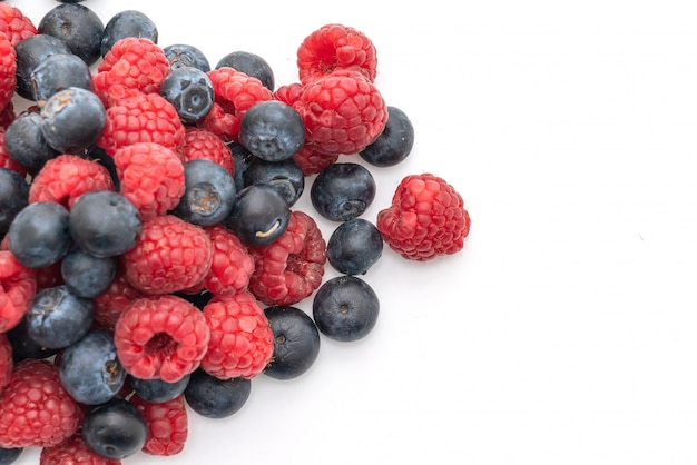 Fresh raspberries and fresh blueberries on white background Premium Photo