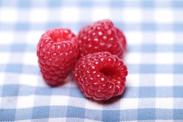 Fresh raspberries on the table Free Photo
