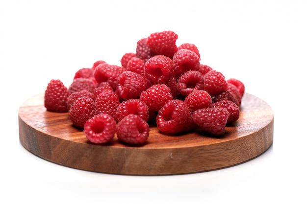 Fresh raspberries on wooden surface Free Photo