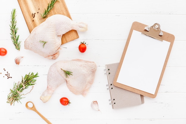 Fresh raw chicken legs with herbs. cooking concept Premium Photo