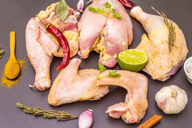 Fresh raw pieces of organic (bio) poultry chicken. Premium Photo
