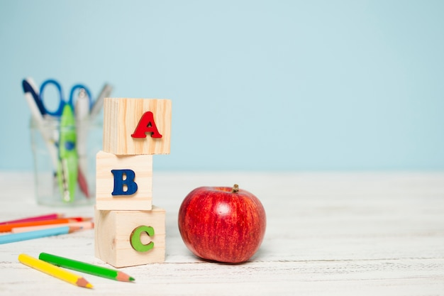 Fresh red apple and school supplies Free Photo