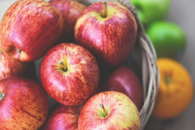 Fresh red apples orchard harvest apple in the basket collect fruit garden Premium Photo