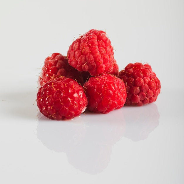 Fresh red raspberries on white background Free Photo