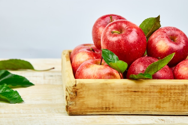 Fresh red ripe apples fruits in the wooden box Premium Photo