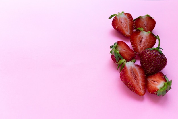 Fresh red ripe strawberries on pink background top view copyspace Premium Photo