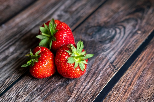 Fresh red scottish strawberries on top of wooden table Free Photo