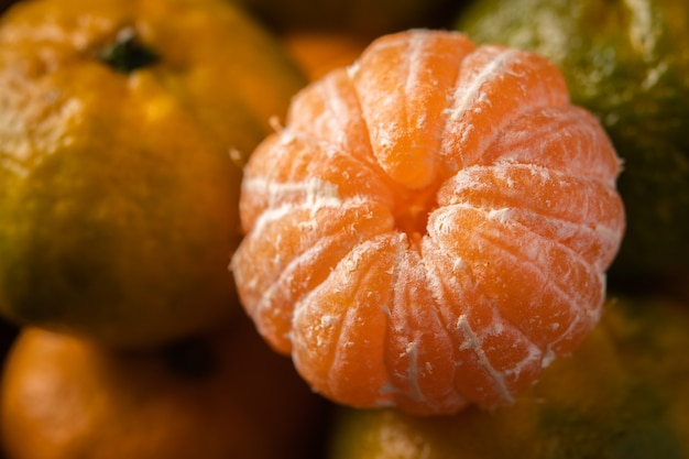 Fresh ripe mandarins background close up, macro, selective focus Premium Photo