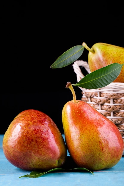 Fresh ripe organic pears on rustic wooden table Premium Photo
