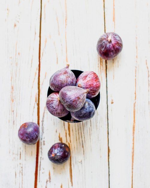 Fresh ripe purple figs on light,  top view Free Photo