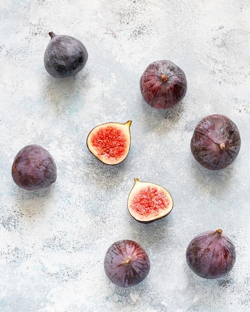 Fresh ripe purple figs on light,  top view Free Photo