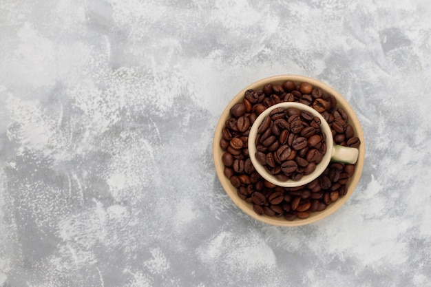 Fresh roasted coffee beans on concrete ,top view,flat lay Free Photo