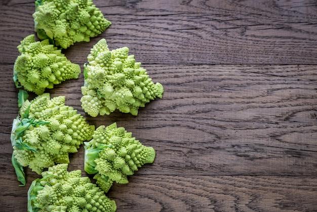 Fresh romanesco broccoli on wooden board Premium Photo
