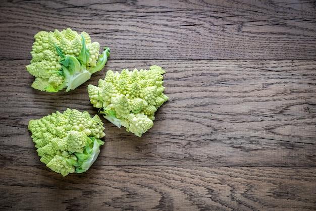 Fresh romanesco broccoli on the wooden board Premium Photo