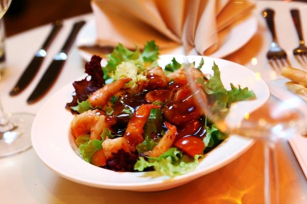 Fresh salad on banquet table Free Photo