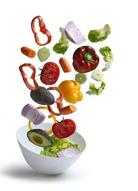 Fresh salad vegetables flying isolated Premium Photo