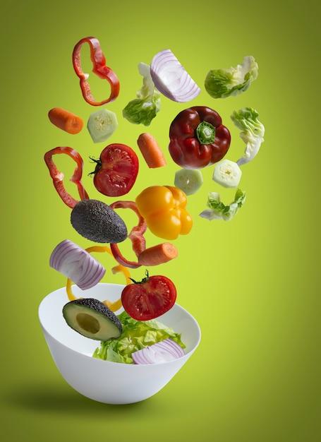 Fresh salad vegetables flying Premium Photo