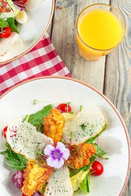 Fresh salad with chicken breast, arugula and tomato. top view Premium Photo