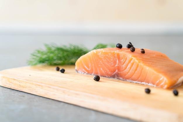 Fresh salmon fillet on board Free Photo
