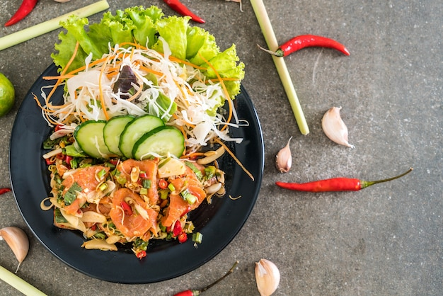 Fresh salmon raw spicy salad Premium Photo