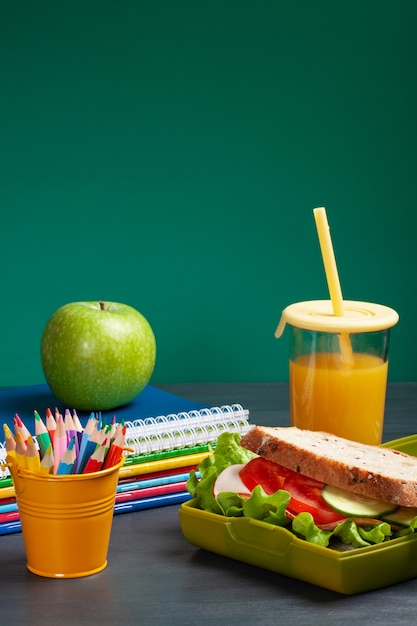Fresh sandwich and apple for healthy lunch in the plastic lunch box Premium Photo