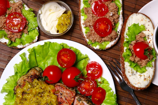 Fresh sandwiches with tuna, vegetables and meat and salad Free Photo