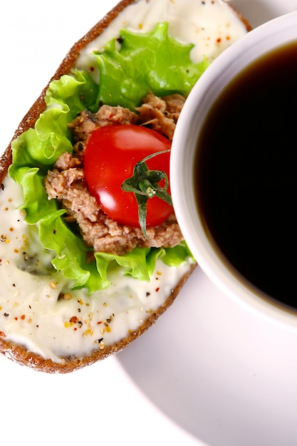 Fresh sanswich with tuna and vegetables and coffee Free Photo