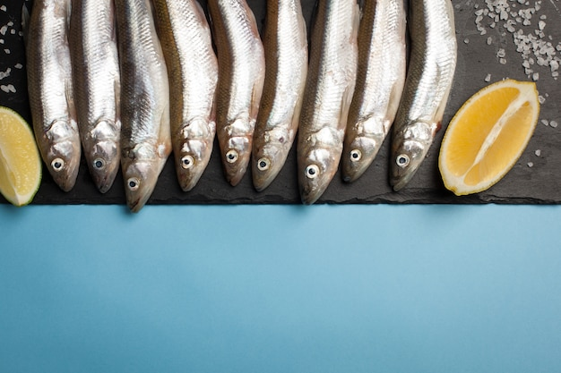 Fresh sea fish smelt or sardines. Premium Photo