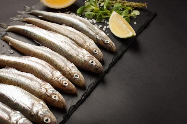 Fresh sea fish smelt or sardines. Premium Photo