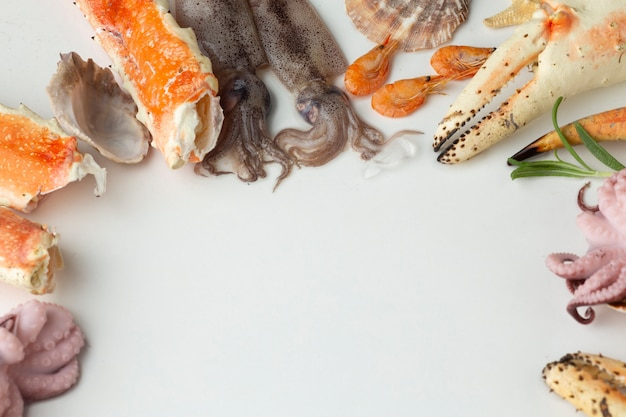 Fresh seafood mix on table Free Photo