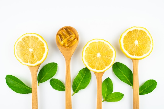 Fresh slice lemon with leaves, vitamin c supplement from natural isolated on white background Premium Photo