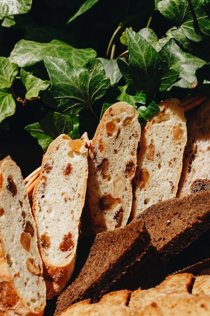 Fresh sliced bread in the restaurant on the basket close-up Premium Photo