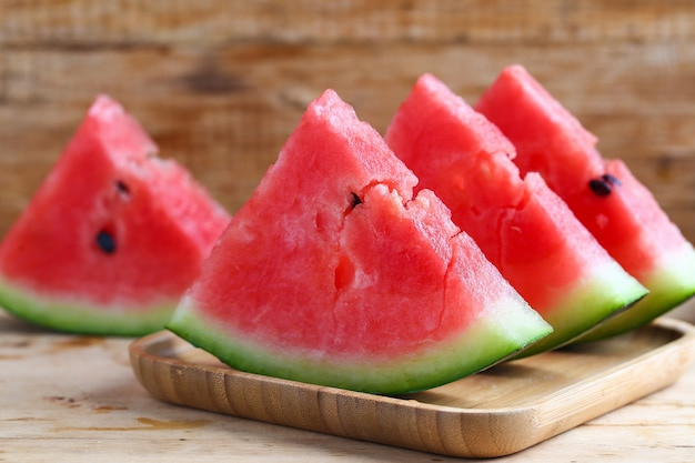Fresh sliced watermelon on wooden background Free Photo